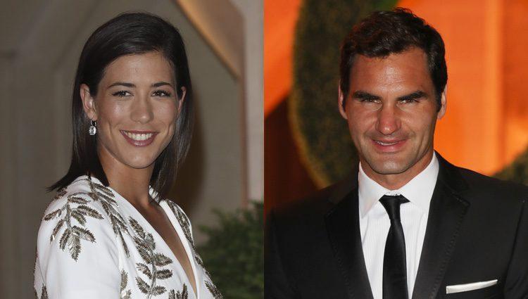 Los ganadores Garbiñe Muguruza y Roger Federer en la cena de gala de Wimbledon 2017