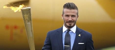 David Beckham con la antorcha olímpica